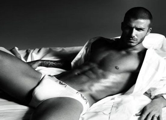 David Beckham shows off abs for Armani ad—2009