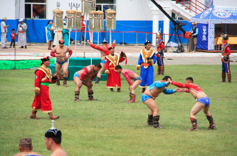 colorful and traditional wrestling at Naadam