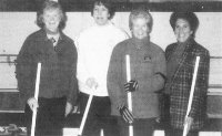 Mickey (in plaid) with curling teammates
