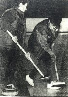 Mickey (right) sweeping the ice