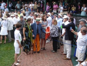 snappy dresser Bud Collins (in orange pants) leaves the ceremony